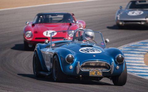 A 1965 Cobra 289 rounds a corner.