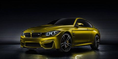 A front three-quarter shot of the BMW M4 coupe concept, being presented at Pebble Beach Concours