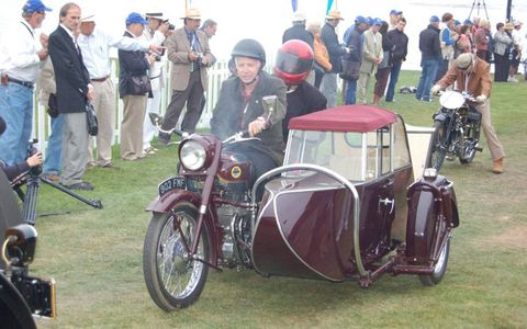 An Ariel Square Four smokes onto the lawn. This was the first year motorcycles were invited to Pebble Beach.