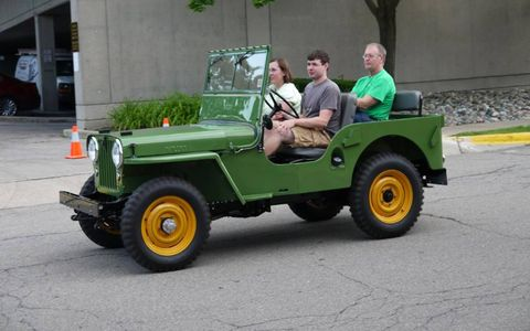 Classic Willys Jeep puttering down Woodward Avenue.