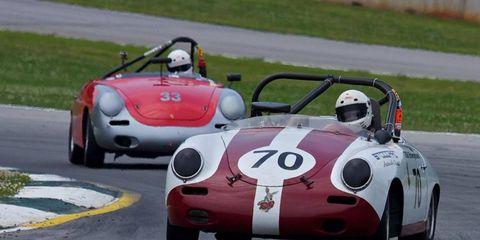 A couple of Porsche 356s drift through turn 12.