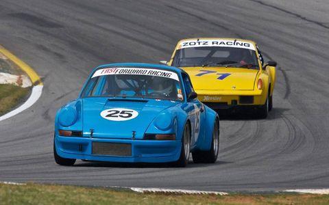 A '73 Porsche 911 RSR leads a 914/6 through turn one.