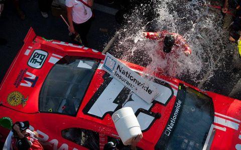 Justin Allgaier celebrates in victory lane.