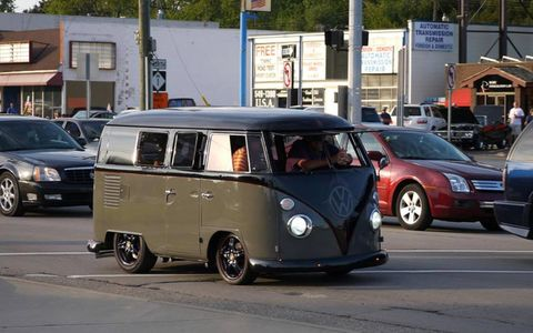 A slammed VW bus rolling down Woodward Avenue.