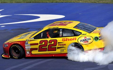 Logano spins out after win.