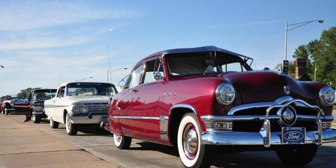 A 1950 Ford heads one lineup of classics parked on Woodward on Friday evening