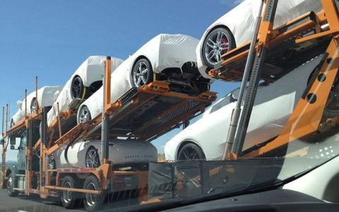 A trailer full of 2014 C7 Corvette Stingray coupes spotted outside of Albuquerque.