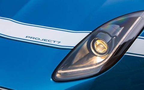 Motor vehicle, Automotive design, Automotive lighting, Headlamp, Car, Hood, Light, Grille, Logo, Electric blue,