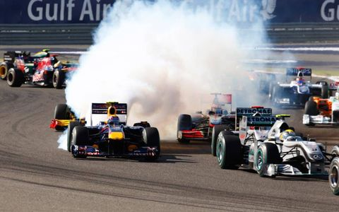 Bahrain International Circuit, Sakhir, Bahrain 14th March 2010 Mark Webber, Red Bull Racing RB6 Renault emits a trail of smoke from his car on the first lap of the race. World Copyright: Lorenzo Bellanca/LAT Photographic