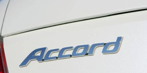 Motor vehicle, Blue, Text, Logo, Electric blue, Azure, Symbol, Parallel, Trademark, Brand,