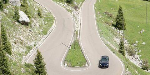 Road, Motor vehicle, Mode of transport, Grass, Green, Road surface, Automotive design, Asphalt, Infrastructure, Landscape,