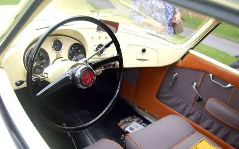 Motor vehicle, Steering part, Mode of transport, Steering wheel, Transport, Classic car, Car, Vehicle door, Speedometer, Gauge,
