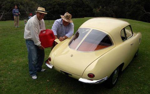 Tire, Wheel, Vehicle, Land vehicle, Hat, Classic car, Car, Fender, Automotive wheel system, Sun hat,