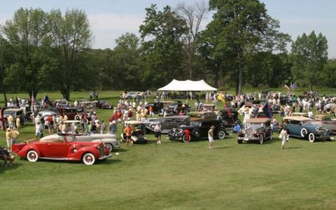 Jewels spread across green velvet at the Meadow Brook Concours early in the day; the crowd got thicker than this later.