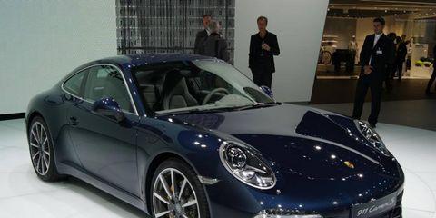 Tire, Wheel, Automotive design, Vehicle, Car, Rim, Performance car, Suit, Coat, Personal luxury car,