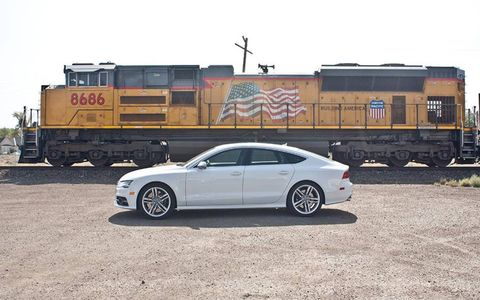 Audi S7 in front of a fine General Motors product: EMD SD70ACe locomotive.