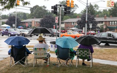Local spectators brave the elements to watch the cruisers.