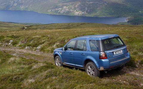 Tire, Wheel, Vehicle, Automotive design, Highland, Mountainous landforms, Car, Automotive tail & brake light, Landscape, Rim,