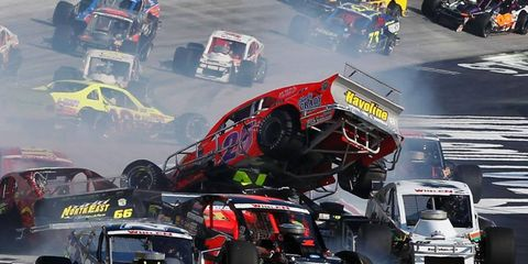 Crash landing // The No. 25 Havoline Plus SVC/Shady Grady Racing Chevrolet, driven by John Smith, goes airborne as other cars spin during the NASCAR Whelen Modified Tour UNOH Perfect Storm 150 at Bristol Motor Speedway on Aug. 22.