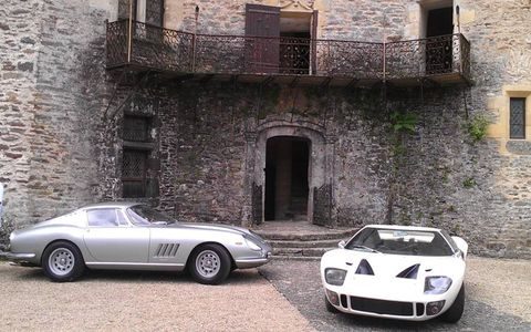 A Ford GT40, right, and Ferrari 275 GTB/4 at lunch break in Chateau de Jumilhac during touring rally.