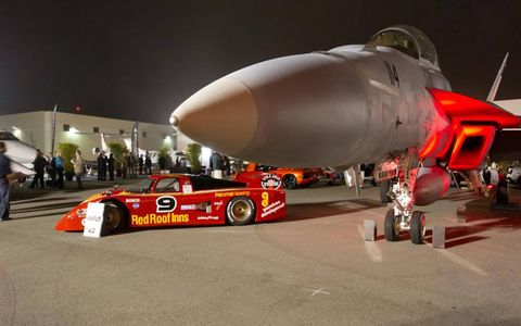 Jet Set: A March 82G Daytona sits next to a Navy F/A-18 fighter jet at the McCall Motorworks Revival in Monterey California.