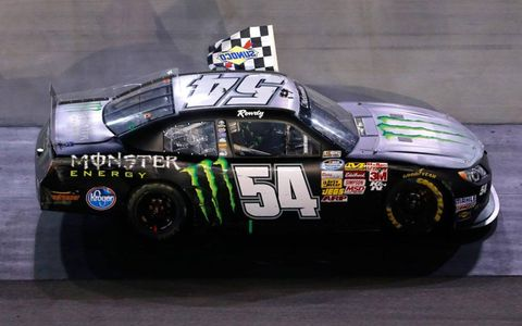 Kyle Busch takes a victory lap on Friday night after his win at Bristol Motor Speedway.