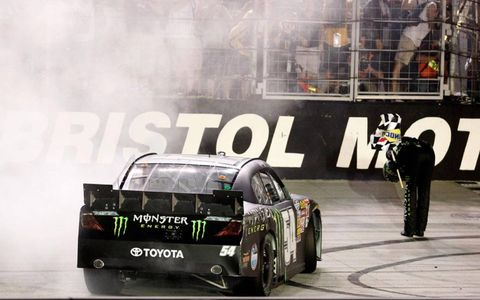 Kyle Busch takes a bow after winning the Food City 250 at Bristol Motor Speedway on Friday night.