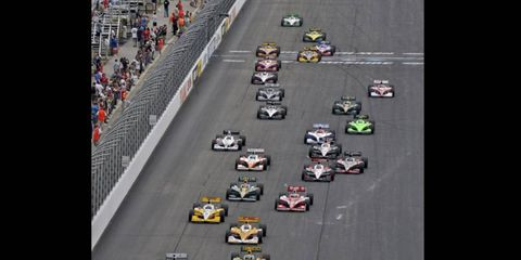 Oriol Servia (right) and Dario Franchitti (left) lead the field at the start of the IndyCar race in Loudon, N.H. on Aug. 14. Photo by: Walt Kuhn/LAT Photographic
