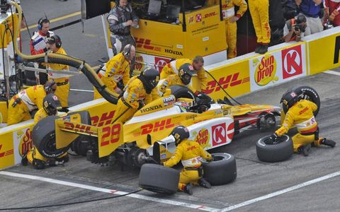 The No. 28 team of Ryan Hunter-Reay goes to work during a pit stop. Photo by: Walt Kuhn/LAT Photographic