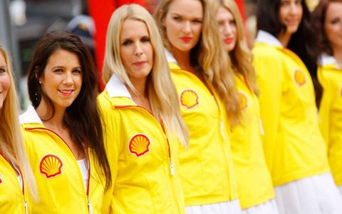 Gird girls waiting for the drivers to take their places on the grid before the start of Sunday's Belgian Grand Prix.