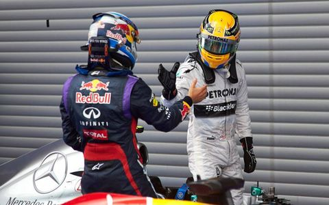 Belgian Grand Prix winner Sebastian Vettel, left, congratulates third-place finisher and pole sitter Lewis Hamilton after the race.