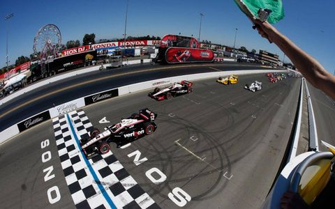 Team Penske drivers Will Power and Ryan Briscoe lead the field at the start of Sunday's race at Sonoma.