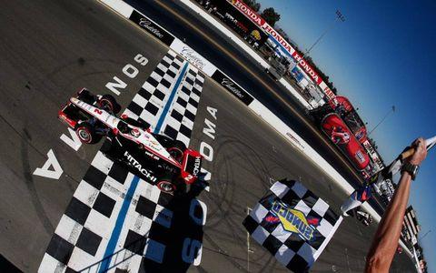 Ryan Briscoe takes the checkered flag.