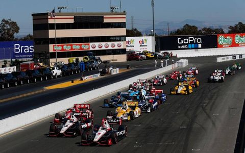 Ryan Briscoe leads the field on a restart at Sonoma.