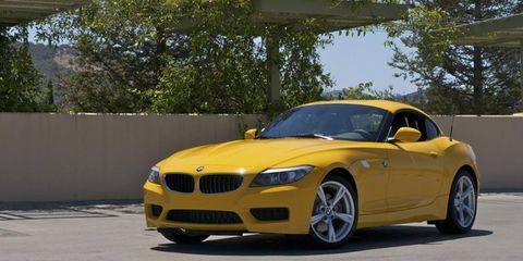 Yellow, Automotive design, Hood, Performance car, Luxury vehicle, Rim, Grille, Personal luxury car, Bumper, Alloy wheel,