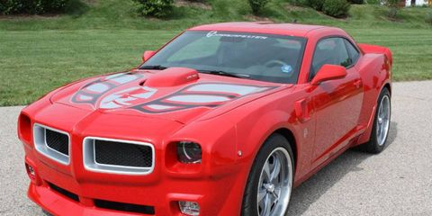Grass, Vehicle, Hood, Rim, Car, Alloy wheel, Red, Fender, Grille, Bumper,