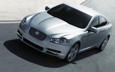 Automotive design, Vehicle, Hood, Automotive mirror, Headlamp, Automotive lighting, Grille, Car, Automotive tire, Rim,