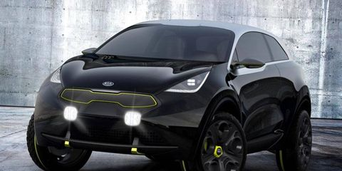The Kia Niro is accented in stainless steel and yellow.