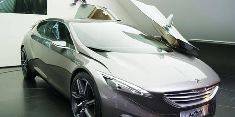 Mode of transport, Automotive design, Vehicle, Land vehicle, Event, Car, Grille, Personal luxury car, Floor, Luxury vehicle,
