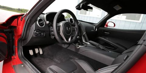 The interior of the 2013 SRT Viper GTS is far more refined especially with the optional Harmon Kardon audio system.