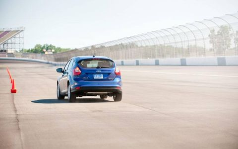 A rear shot of the 2012 Ford Focus Titanium five-door hatchback on track.