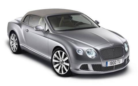 Automotive design, Grille, Car, Fender, Automotive lighting, Bentley, Rim, Vehicle door, Headlamp, Luxury vehicle,
