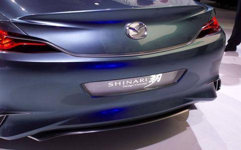 Automotive design, Mode of transport, Event, Vehicle, Car, Automotive lighting, Personal luxury car, Logo, Sports car, Luxury vehicle,