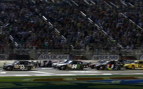 Kevin Harvick fights off Kyle Busch.