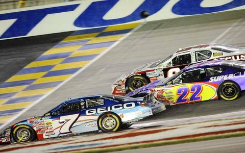 Mike Wallace is run into the grass by Josh Wise and David Stremme