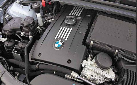 Engine, Automotive engine part, Computer hardware, Machine, Personal luxury car, Hood, Automotive super charger part, Kit car, Automotive air manifold, Carbon,