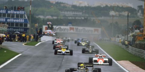 Ayrton Senna leads the field on the formation lap before the start of the 1996 Portuguese Grand Prix.