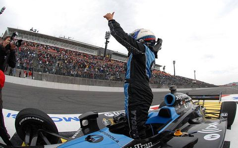 Danica Patrick stands in her car and gives a thumbs up to the crowd at Twin Ring Motegi after winning the Indy Japan 300.