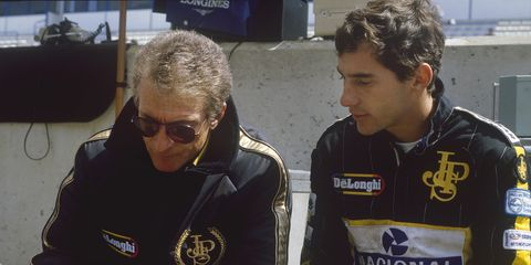 Gerard Ducarouge, left, and Ayrton Senna talk strategy at the Spanish Grand Prix in 1986.