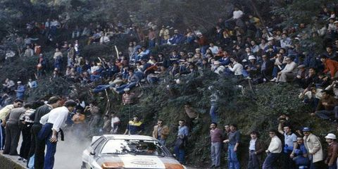 World Rally fans are known for both daring and, sometimes, stupidity when it comes to watching their heroes. A perfect example is this scene from the 1983 Portuguese Rally, where fans line the mountain road to see Hannu Mikkola and co-driver Arne Hertz speeding past in their Audi Quattro A1.